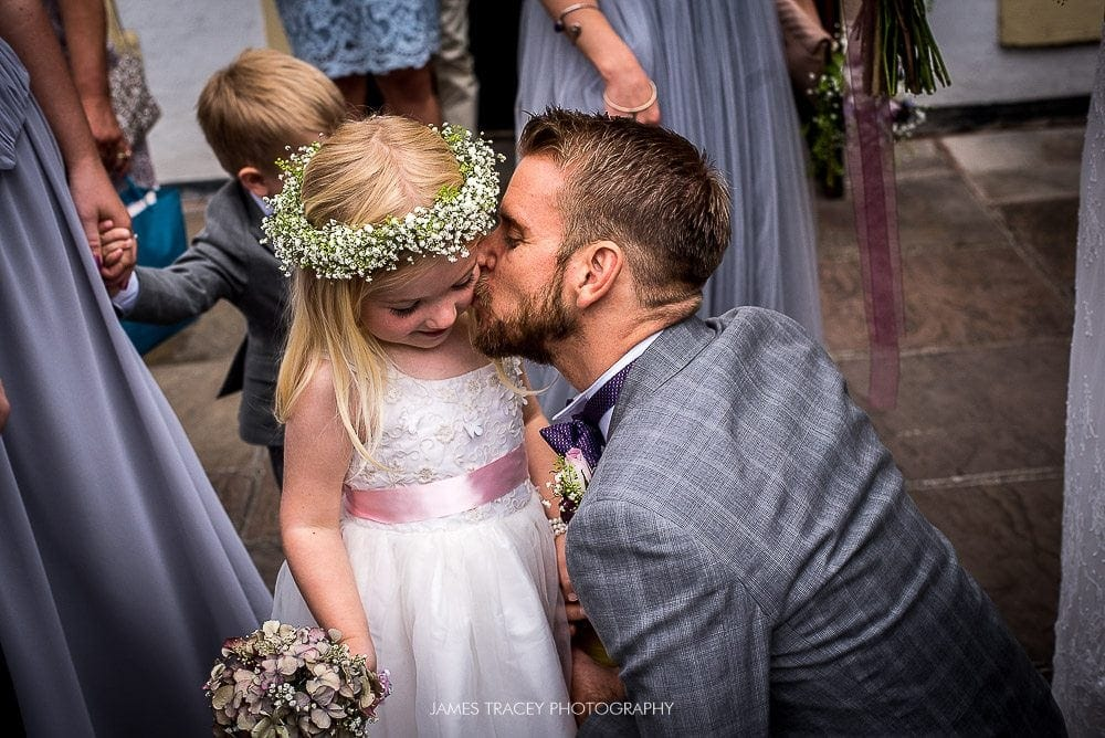 groom kissing his daughter
