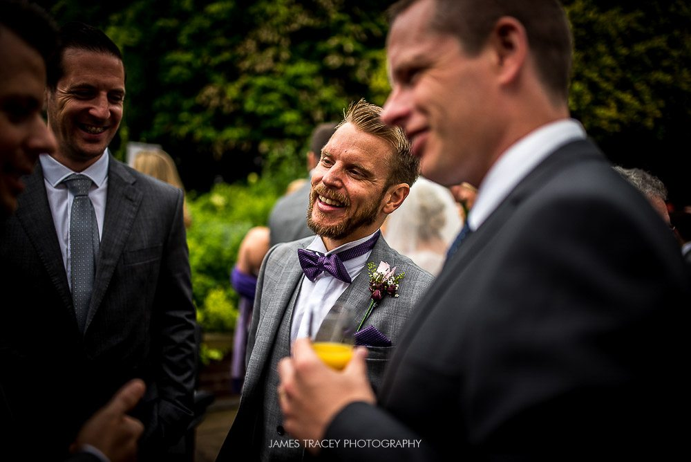 groom chatting with friends
