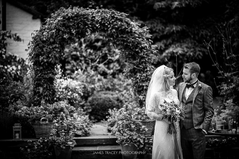 bride and groom in belle epoque garden