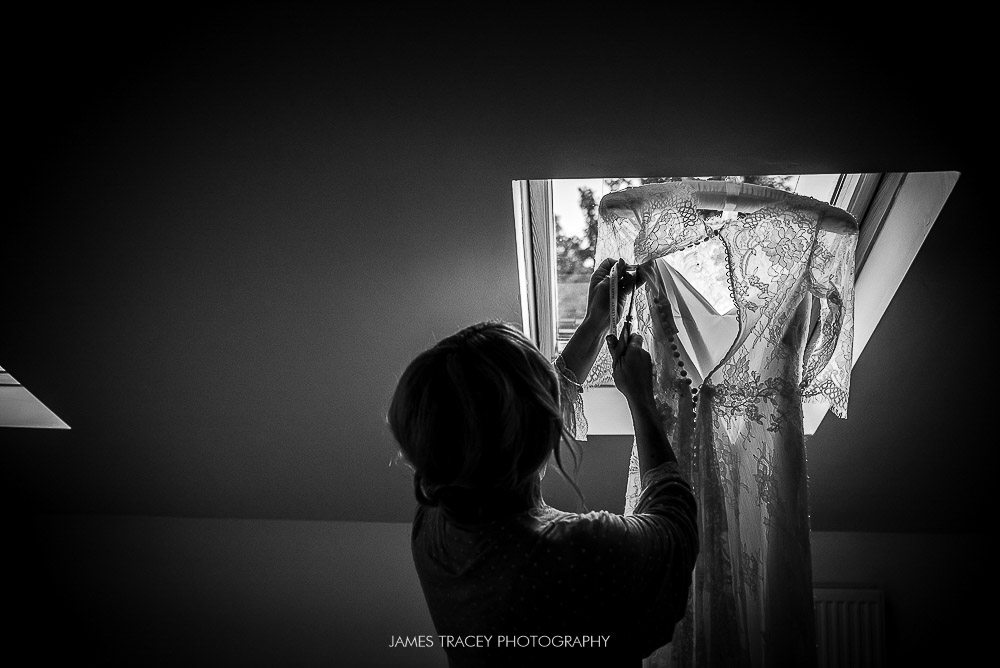 bride checking her wedding dress