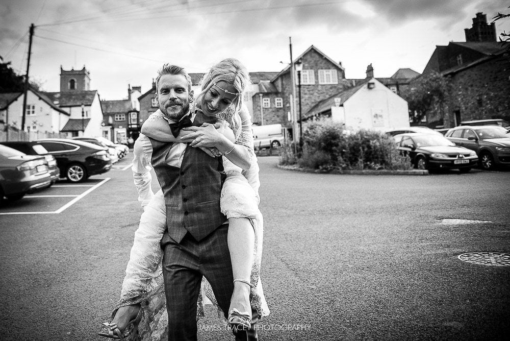 bride having a piggy back