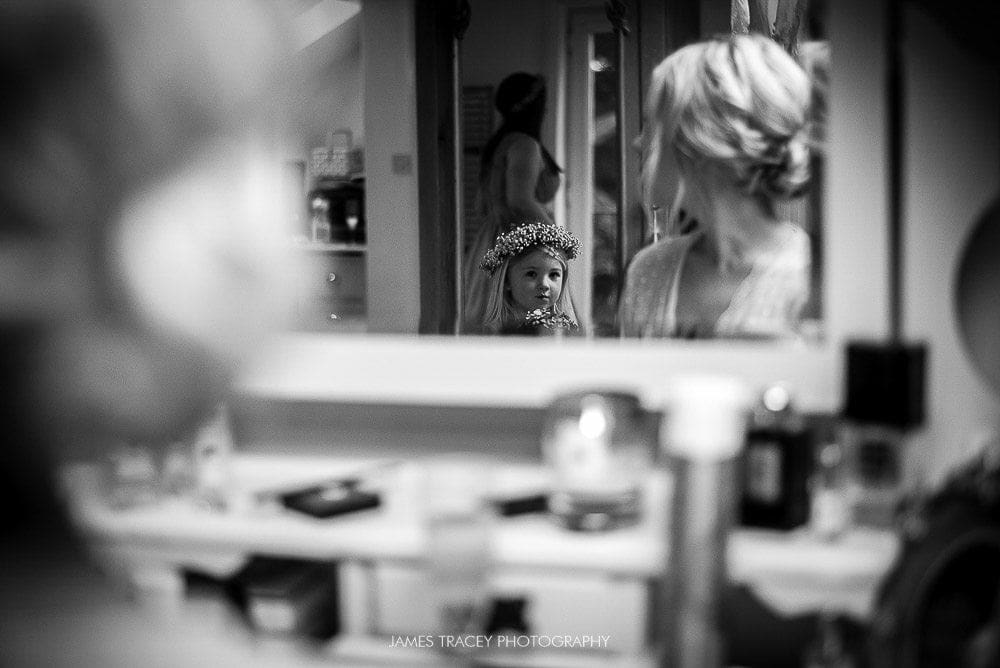 brides daughter reflected in mirror