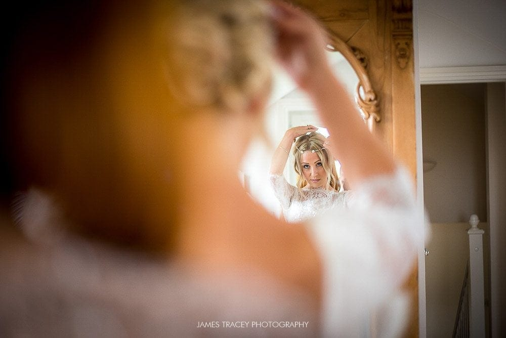 bride adding her hairpiece