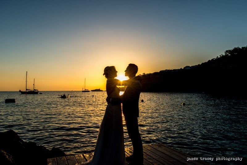 bride and groom silhouetted in front of ibiza sunset