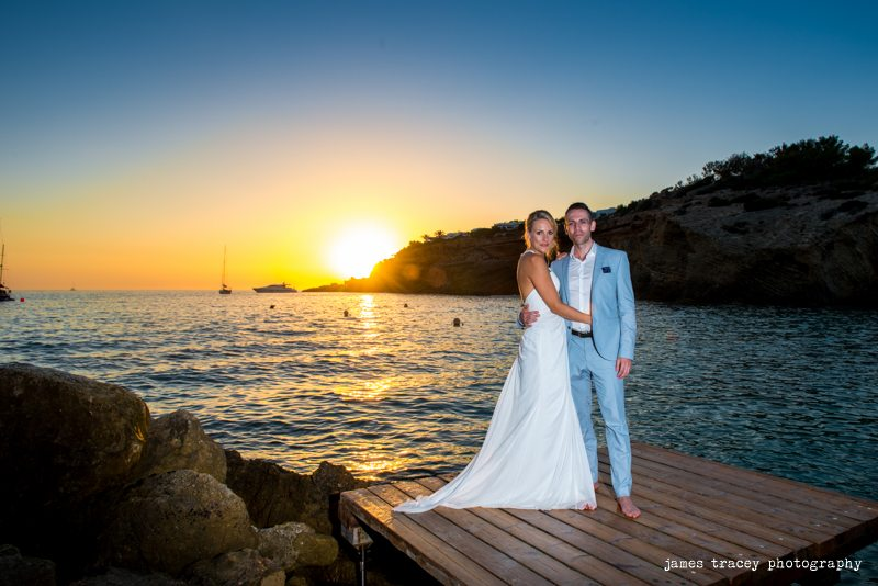 bride and groom in front of ibiza sunset