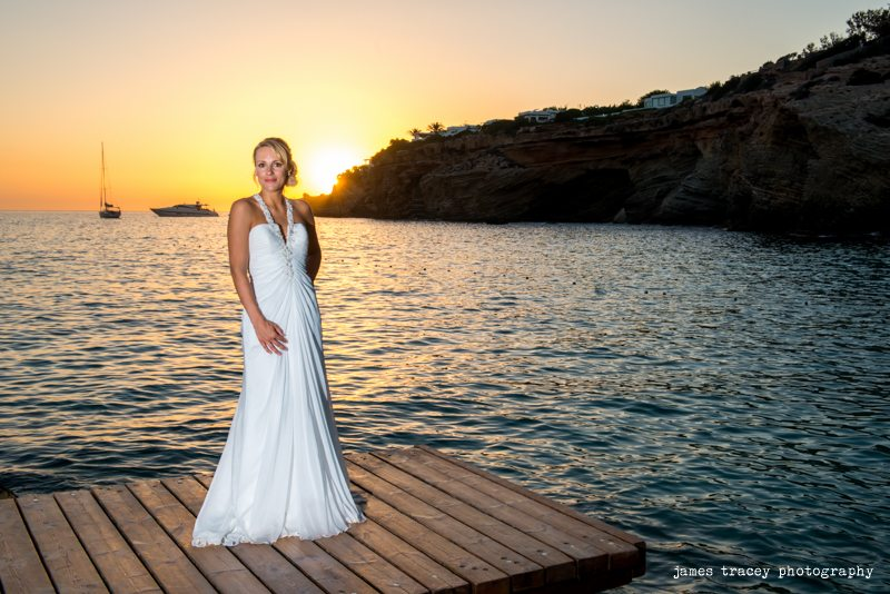 bride posing on a jetty in ibiza