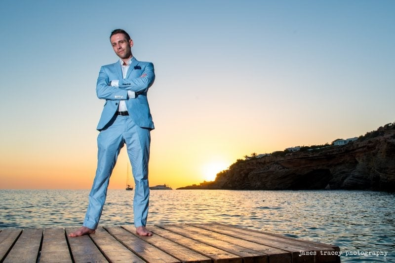 groom with arms folded on a jetty in ibiza