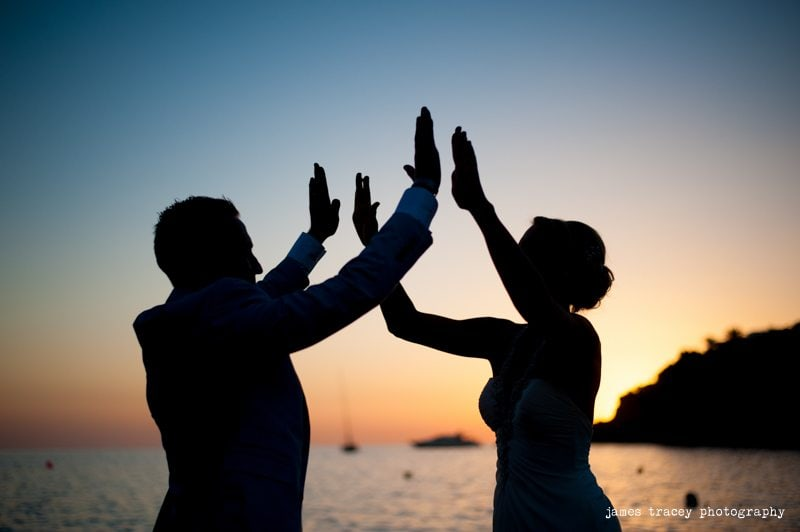 bride and groom high fiving in ibiza