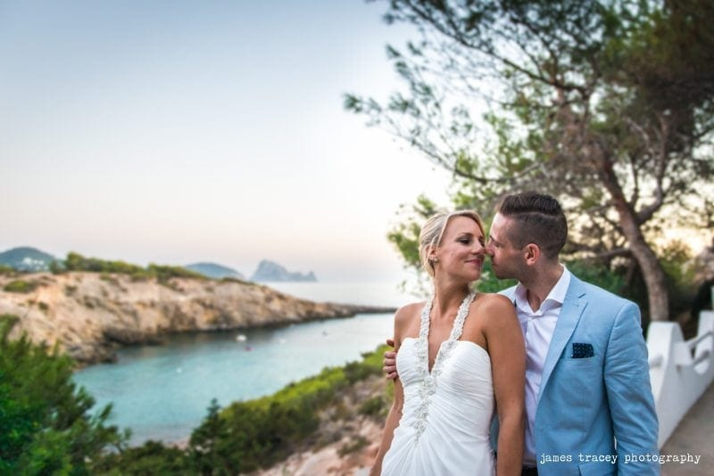 bride and groom overlooking a beach in ibiza