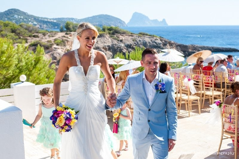 bride and groom walking down the aisle at elixir shore club ibiza