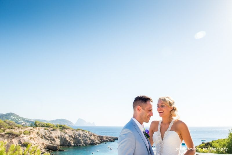 bride and groom in front of the sea