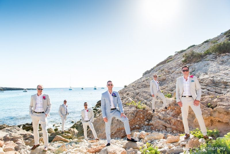 groom and best man and ushers on rocks in ibiza