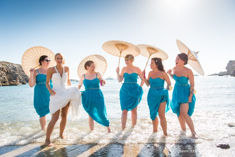 brides and bridesmaids in the sea in ibiza