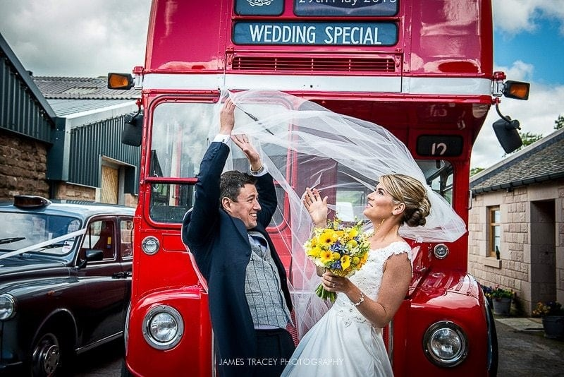 bride and groom at heaton house farm in front of a routemaster bus