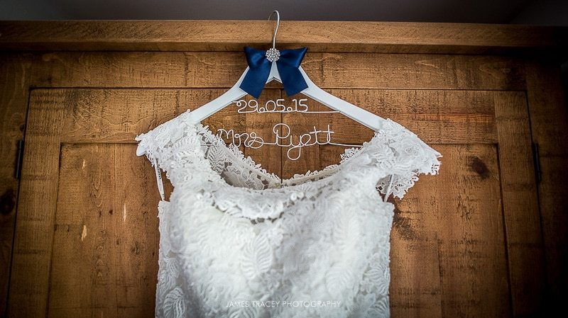 wedding dress hanging in front of wardrobe