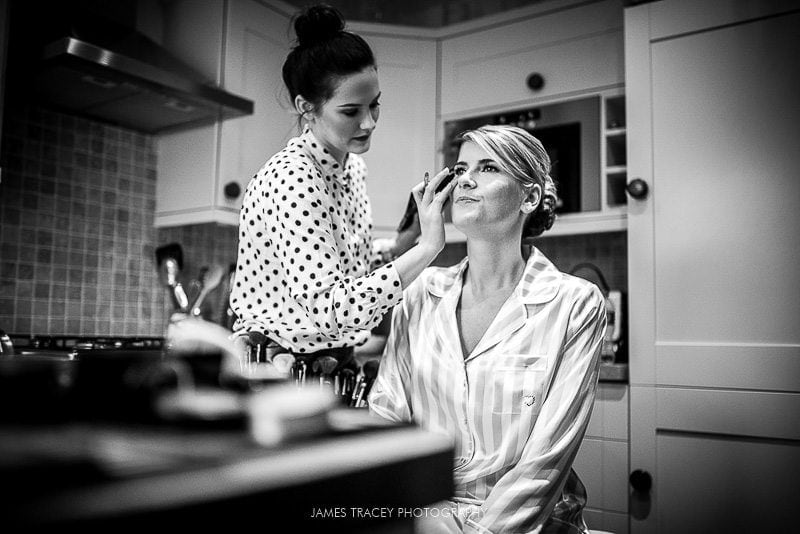 bride having make up applied before her wedding at heaton house farm