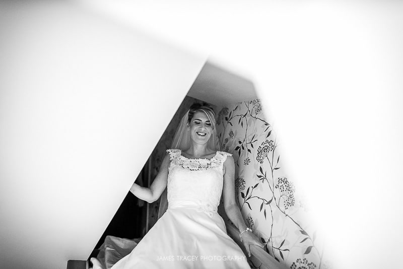 bride walking down the stairs for her heaton house farm wedding