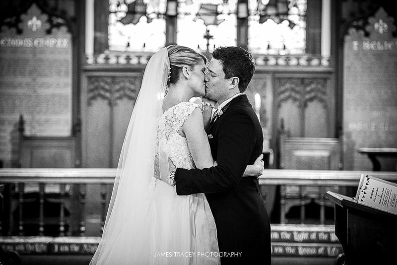 first kiss at a wedding in Pott Shrigley Church