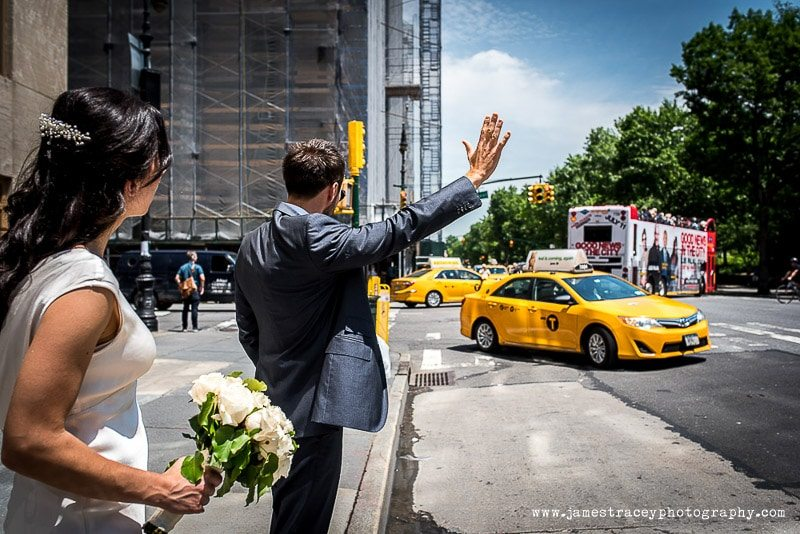 groom hailing a yellow nyc cab