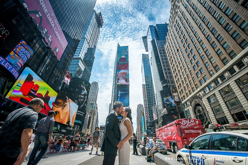 Bride and groom kissing in Times Square New York