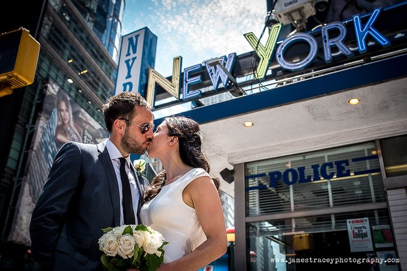 Bride and groom in front of NYPD sign Times Square