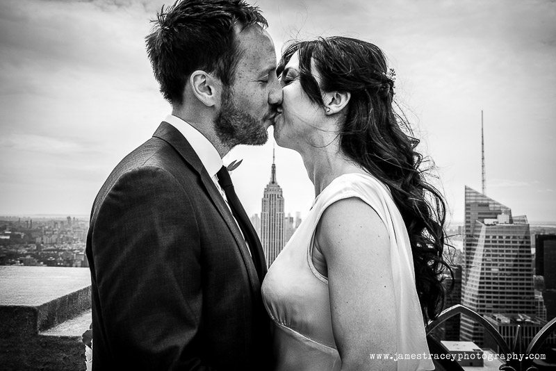 empire state building in between kissing bride and groom