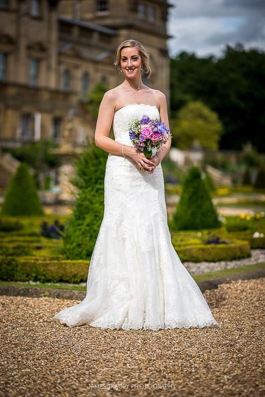 bride with bouquest in front of harewood house