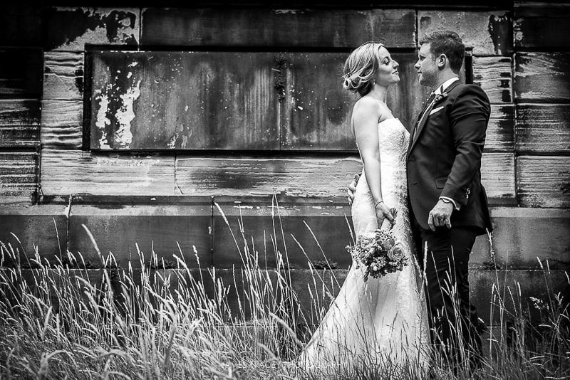 bride and groom kissing in black and white