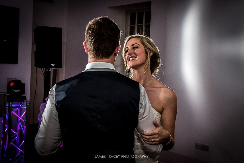 bride and groom having their first dance at harewood house