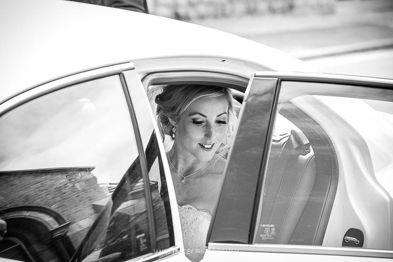 bride sat in wedding car
