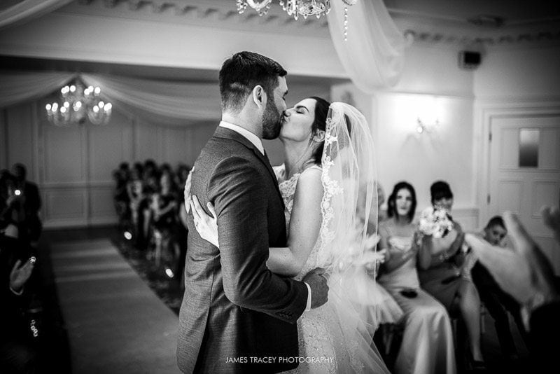 bride and groom first kiss at eaves hall