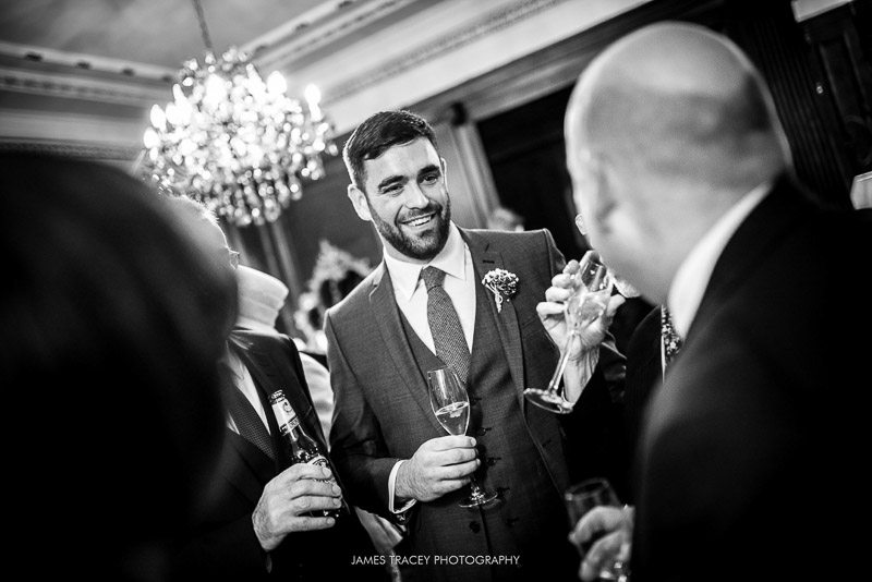 groom talking to friends