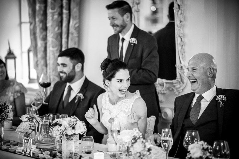 bride laughing at eaves hall wedding