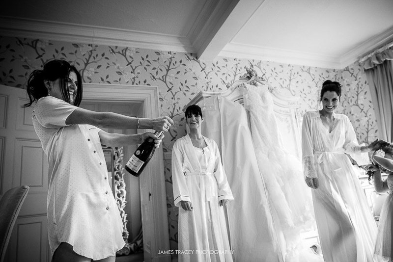 bride opening champagne bottle
