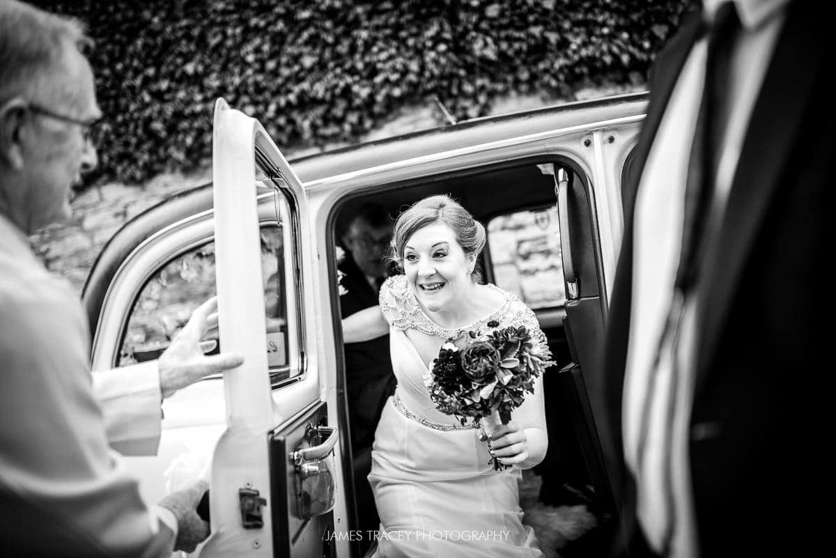 bride getting out of a white london taxi