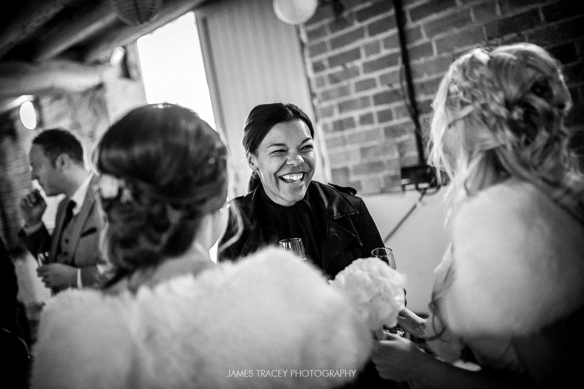 laughing wedding guest at pimhill barn