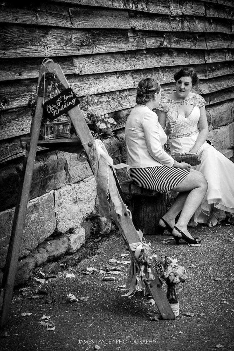 bride sat on a bench at pim hill barn wedding