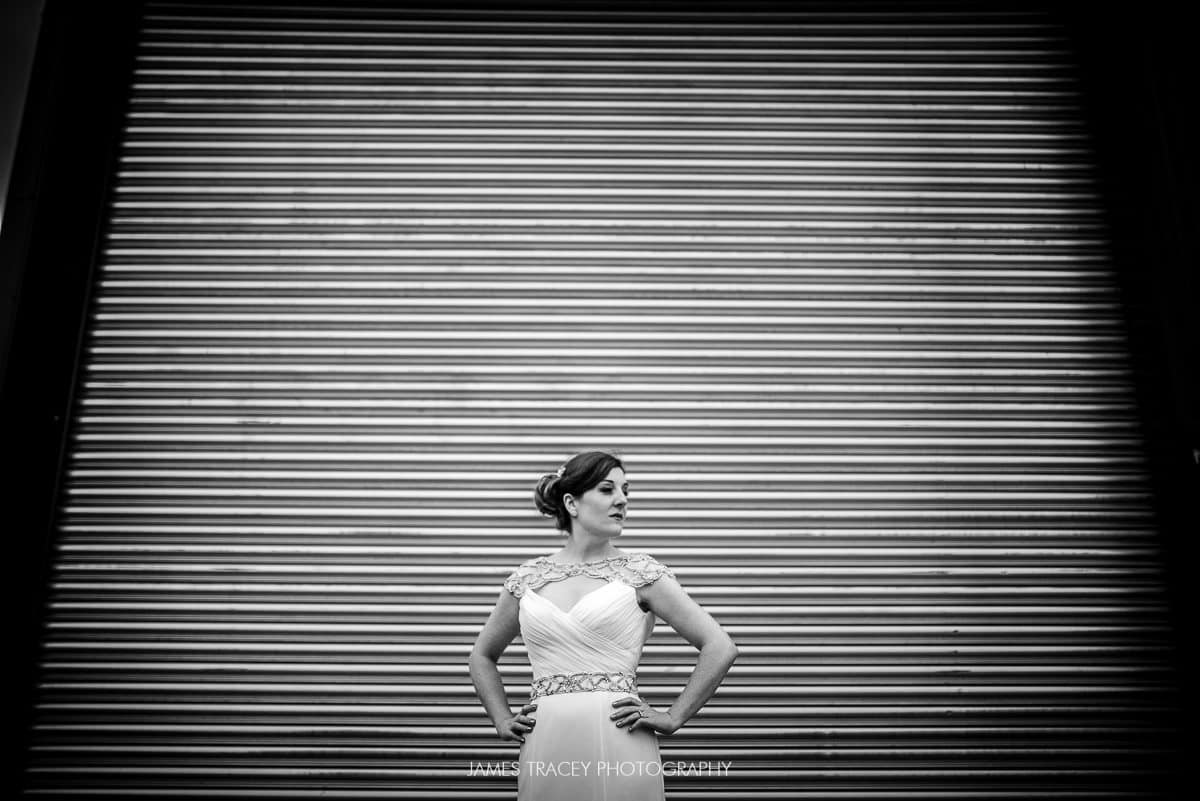 bride posing in front of shutter