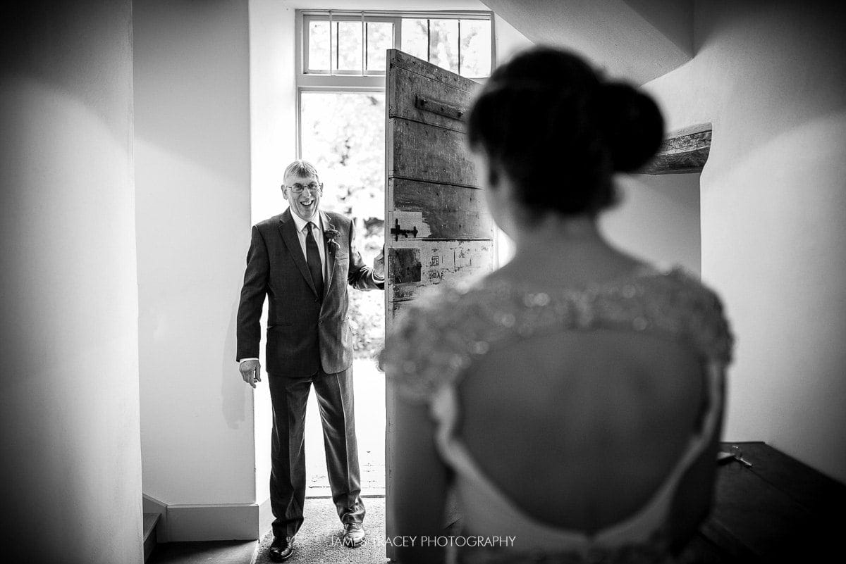 father of the bride seeing his daughter in her wedding dress