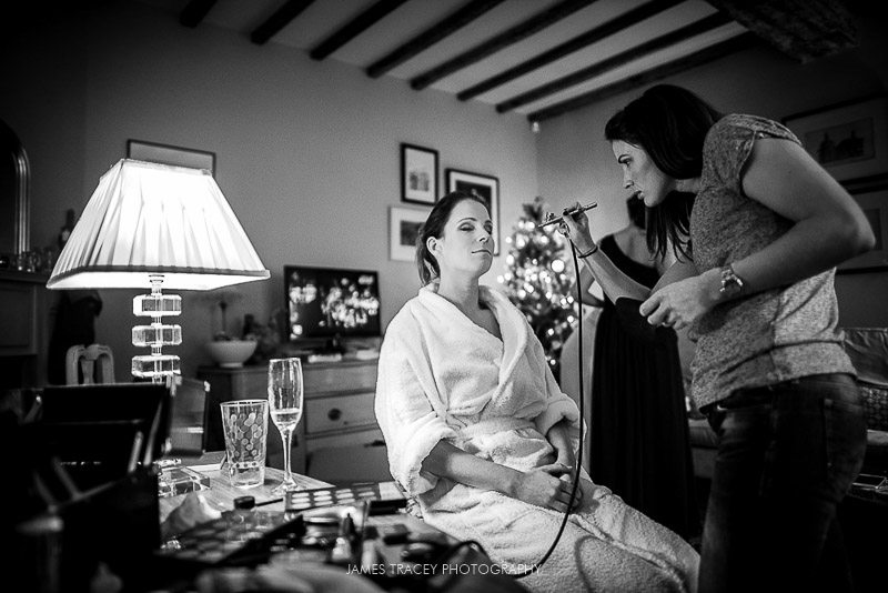 bride having her make up applied