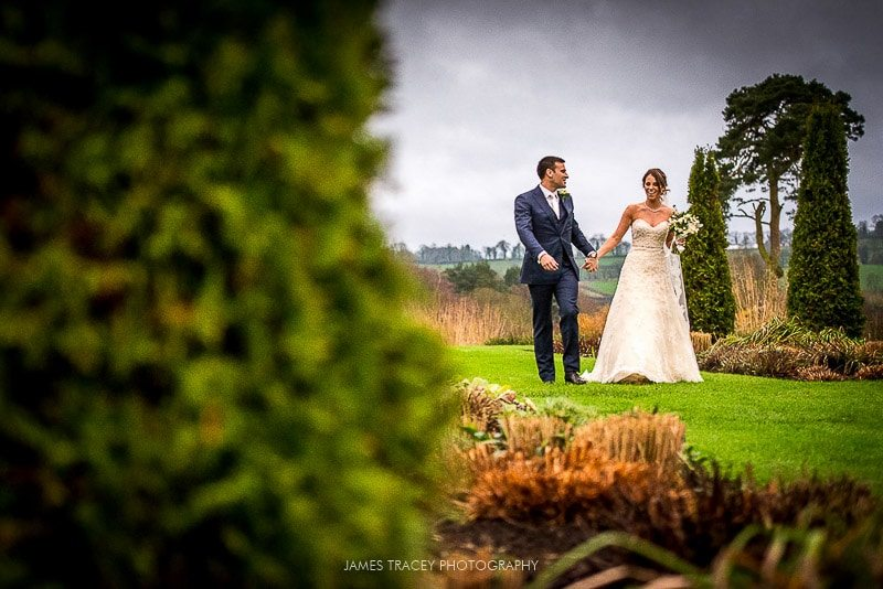 bride and groom walking at abbeywood estate