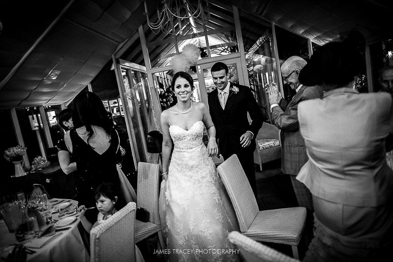 wedding couple walking into reception