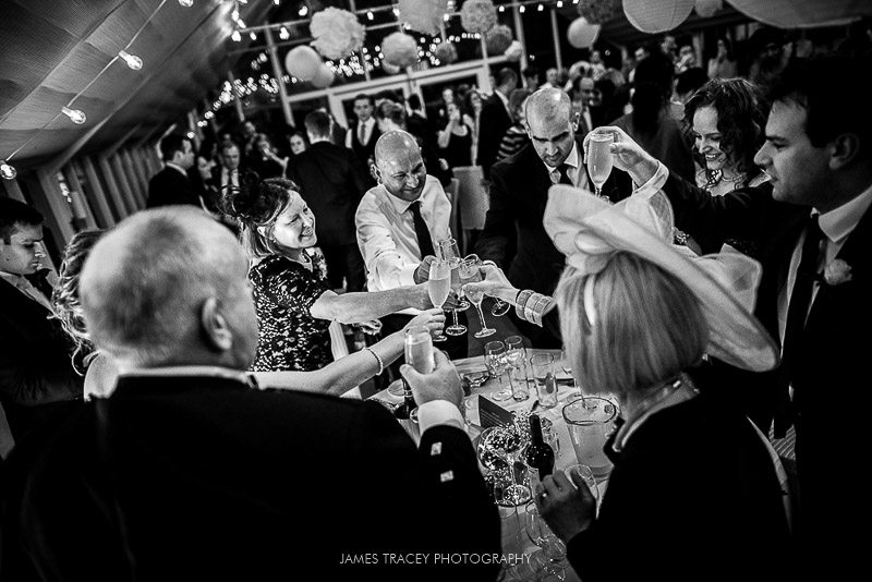 wedding guests toasting the couple