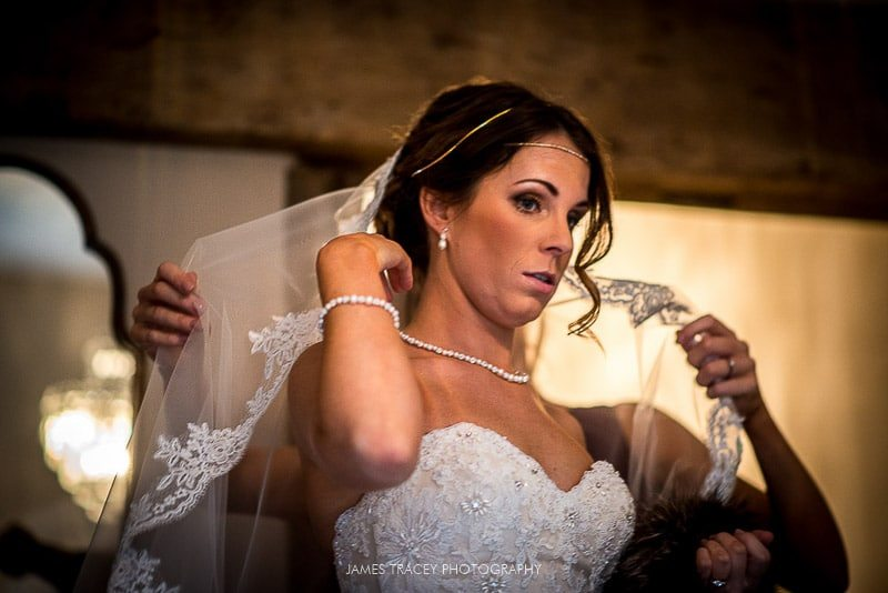 close up photo of bride getting ready