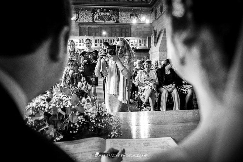 friends taking photos at wedding