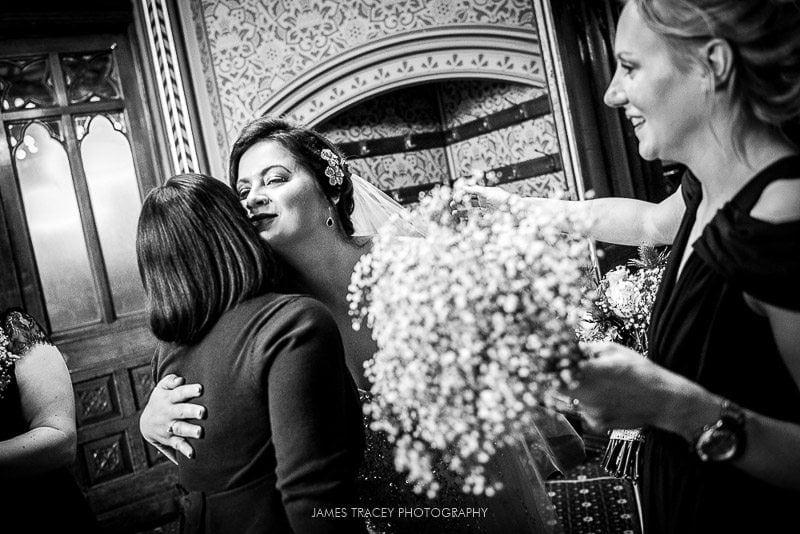 bride hugging guests