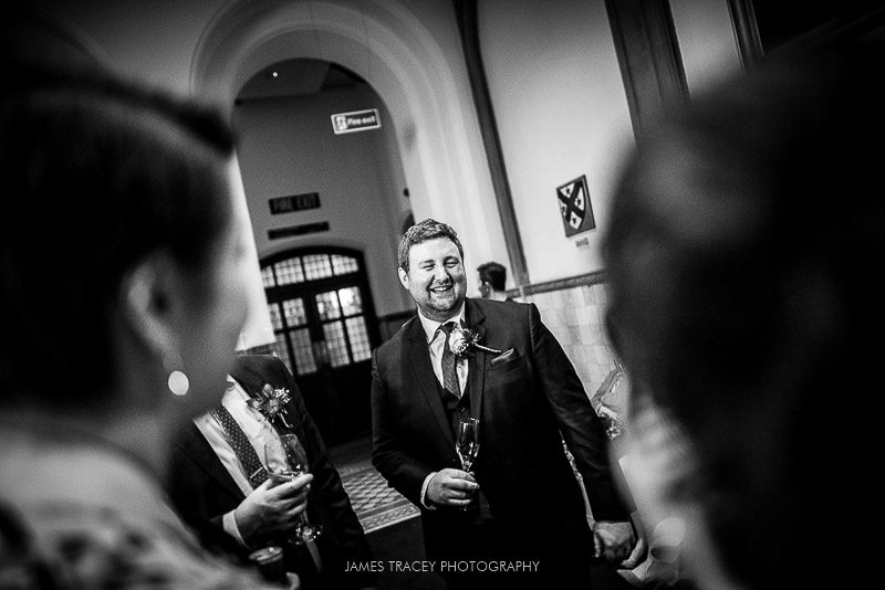 groom laughing at guests