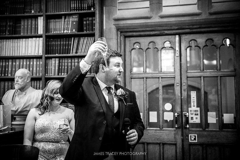 groom toasting bride