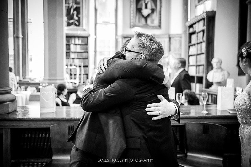 hugs at a wedding