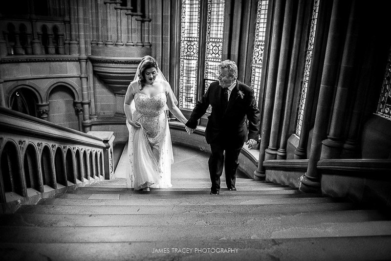 bride walking up stairs at manchester town hall